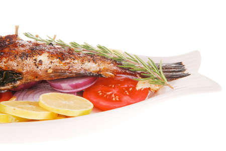 sunfish: savory: whole fryed sunfish over plate with tomatoes lemons and peppers