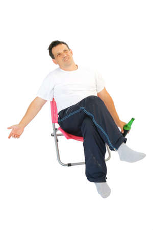 single beer bottle: image of single man resting with bottle of beer Stock Photo