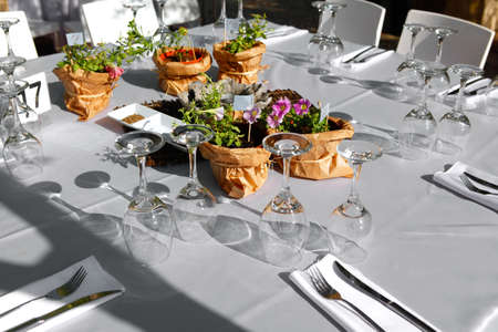 served holiday table with glasses flowers and cutlery photo