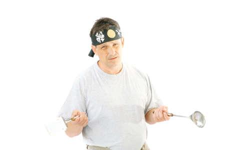 headband: single man play with kitchen tools in headband Stock Photo