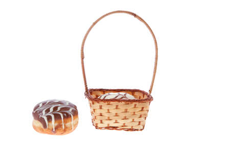 chanuka: traditional jewish holiday chanuka donuts covered by dark and white chocolate pattern on retro vintage basket isolated on white background