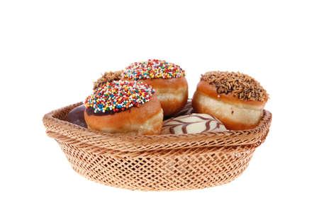chanuka: traditional jewish holiday chanuka donuts covered by dark chocolate on retro vintage basket isolated on white background