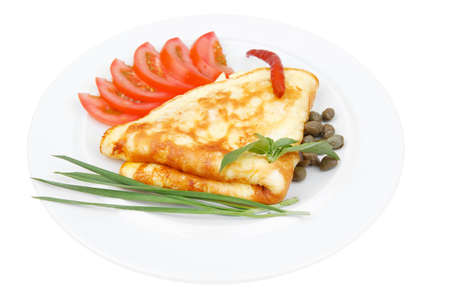 whites: omelette with tomatoes and pepper served on white plate isolated on white background