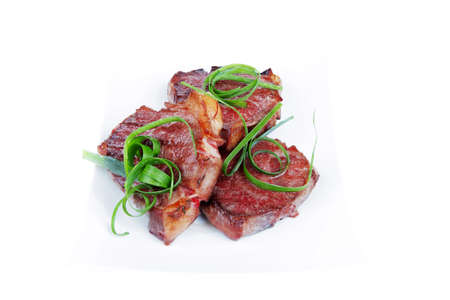 steak beef: roasted beef meat strips steak on white ceramic plate isolated over white background