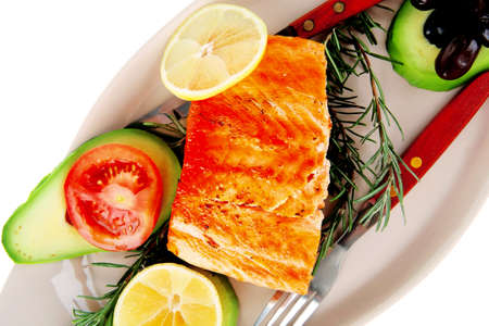 roast fish: hot grilled salmon on glass plate isolated on white background photo