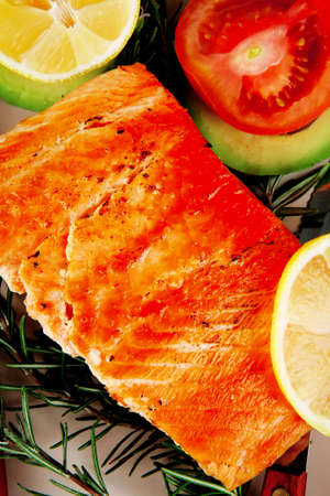 healthy food: hot baked salmon piece served over glass plate isolated on white background photo