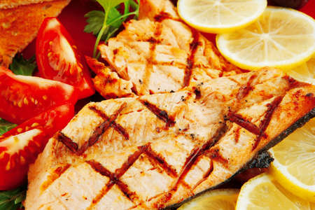 pink salmon: grilled pink salmon with lemon and toasts Stock Photo