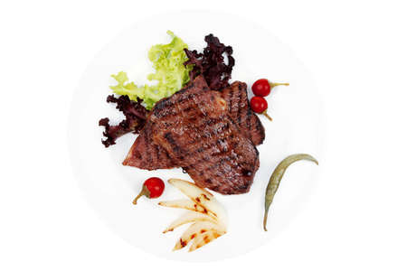 meat food : two grilled steak with chili and red peppers , green lettuce salad , on dish isolated over white background Stock Photo