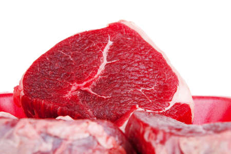 circular muscle: fresh meat : raw uncooked fat lamb pork fillet mignon loin on red tray isolated over white background