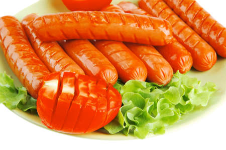 lean over: roasted beef sausages over white with salad and ketchup Stock Photo