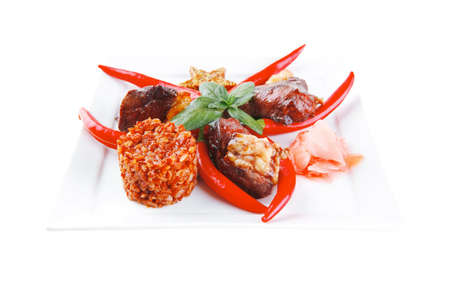 lean over: grilled meat chunks on white plate over white Stock Photo