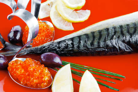 golden fish: golden fish with lemon and olives on red