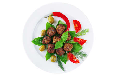 roasted cutlets served on basil with vegetables photo