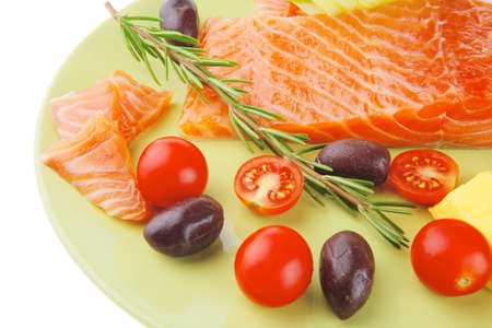 fresh smoked salmon fillet with vegetables and rosemary photo