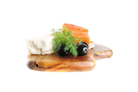 pink salmon: sinlge pink salmon bit on a big wooden dish with white cheese