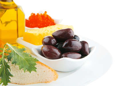 served olive oil, salmon caviar, and baguette Stock Photo