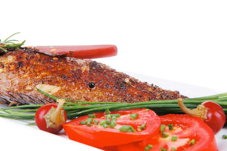 sunfish: main course isolated on white: whole fryed sunfish on plate with lemons and peppers