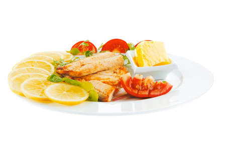 king salmon: image of grilled salmon with vegetables on white