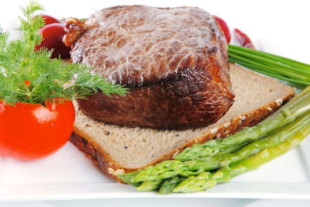 beef meat on bread with asparagus and spices photo