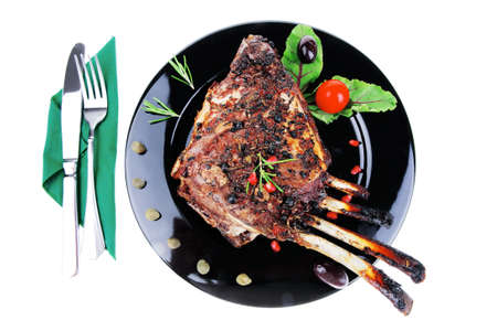 baby cutlery: grilled baby ribs on black plate with cutlery Stock Photo