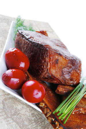 grilled meat served with vegetables and bread photo