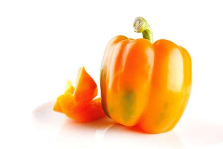 fresh orange bell pepper isolated over white background