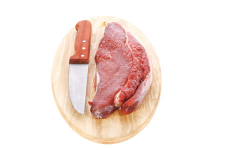 beefsteak: raw meat beefsteak fillet with knife oon wood isolated over white background