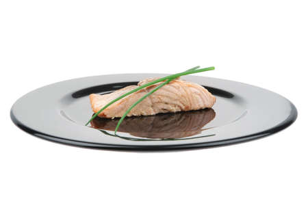 pink salmon: sea food : roasted pink salmon fillet with chinese onion, on black dish isolated over white background