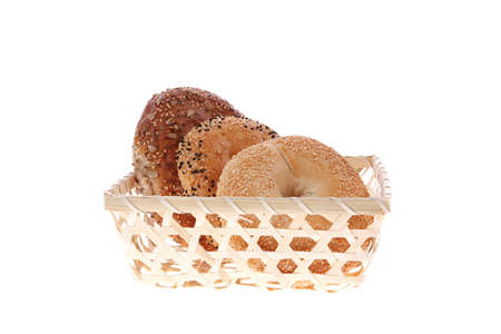 three different bagels in basket isolated over white background photo