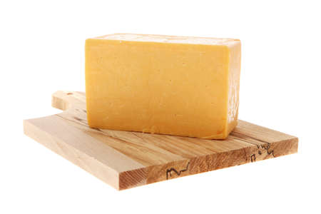 wood blocks: aged italian deli fresh cheddar cheese served on wooden cutting plate isolated over white background