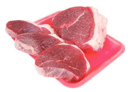 circular muscle: butchery : fresh raw beef lamb big fillet mignon ready to cooking on red tray isolated over white background