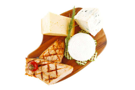 edam: grilled sea fish salmon with french edam gorgonzola and soft feta goat cheeses on wooden plate isolated over white background Stock Photo