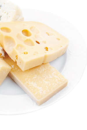 edam: edam parmesan and brie cheese on white platter isolated on white background Stock Photo
