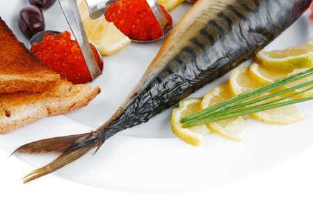Diet food - red caviar and smoked mackerel fish with lemon tomatoes and bread on white china plate isolated over white  photo