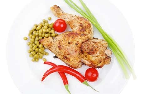 meat food: meat food : roast chicken garnished with green onion and red chili hot pepper on white plate isolated over white background Stock Photo