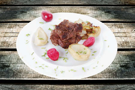 traditionally american: beef bourguignon in wine with artichoke and marinated vegetables on white plate isolated over white background Stock Photo
