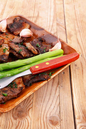 meat grilled: beef pork meat grilled ribs with asparagus and garlic over wooden background table Stock Photo