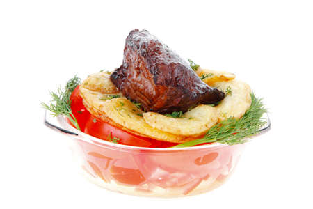 fill fill in: fresh roast beef meat chunk in transparent bowl over baked potatoes and tomatoves served with fill isolated over white background