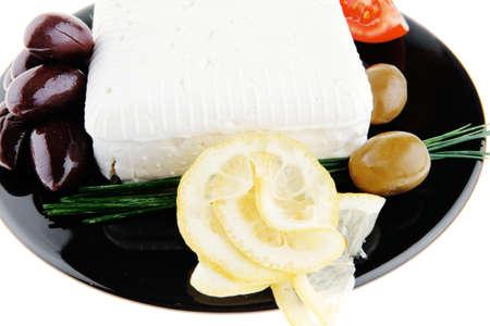 image of feta cube on black plate photo