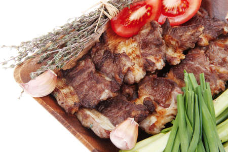 meat grilled: beef meat grilled ribs with asparagus and tomatoes isolated over white background