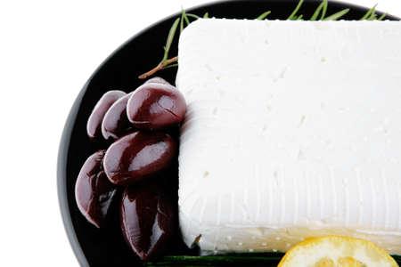 soft feta cheese on black plate photo