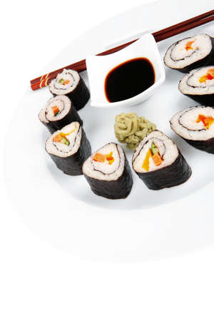 sake maki: Japanese Traditional Cuisine - California Roll with Salmon (sake), Cream Cheese and Tuna (maguro) on white dish with sticks isolated over white background
