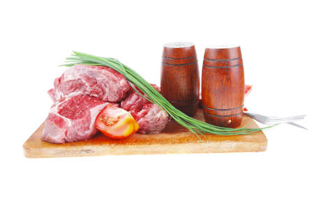 pepper castor: fresh raw beef steak cut board with green chives and tomatoes isolated on white background