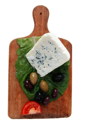 stilton: stilton cheese on wooden platter with olives and tomato isolated over white background