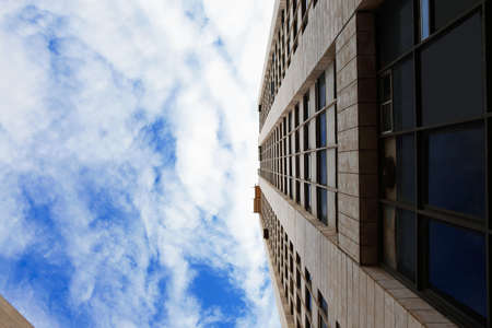 concrete commercial block: city tower urban sky with clouds