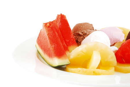freezed: watermelon plum and slice of pineapple and chocolate and fruit ice cream on white plate isolated over white background
