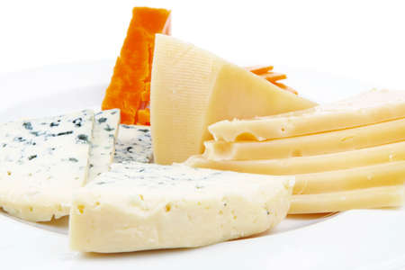 sustained: french delicatessen aged cheeses chops served on white plate with slices isolated on white background
