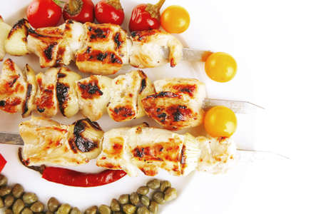 alcaparras: fresh turkey barbecue shish kebab served with tomatoes capers on platter isolated over white background