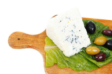 roquefort: roquefort cheese on wooden platter with olives and tomato isolated over white background Stock Photo