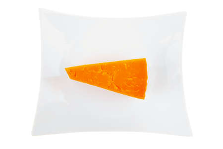 cheez: piece of french cheddar cheese on a ceramic plate isolated over white background